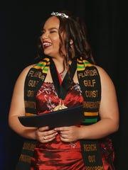 Island Coast High School student Judith Otero accepts
