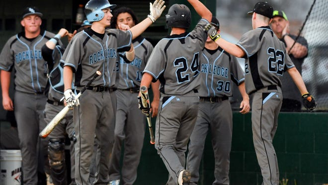 Rockledge players welcome home Robby Whitaker (24) after he scored in a game against Melbourne.