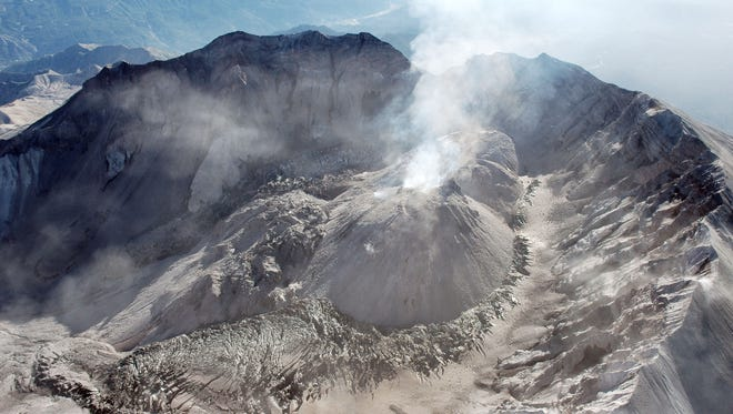 In this Sept. 12, 2006, file photo, provided by the United States Geological Survey, Cascades Volcano Observatory, Mount St. Helens' crater, dome, and west arm of the crater glacier are shown as seen from the west.