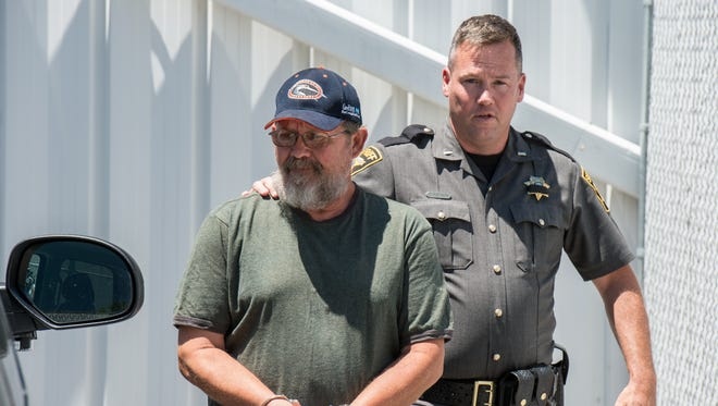 Robert Murphy, of Eden, escorted by Wicomico County Sheriff's office on Monday, July 11, 2016.