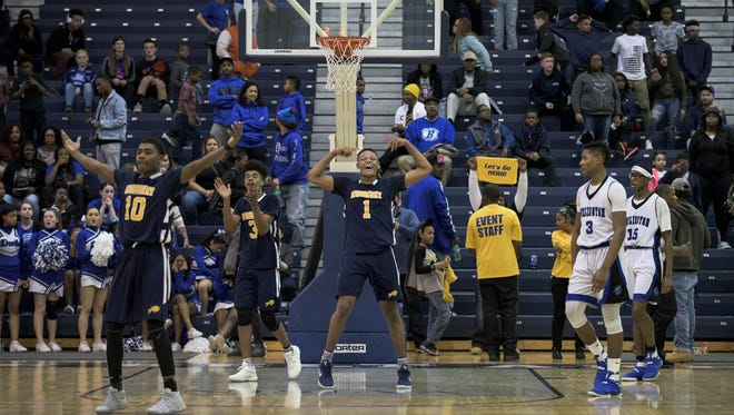 Woodbury's Ja'Zere Noel (1) flexes his muscles after the Thundering Herd defeated Burlington City 60-51 in the Group 1 state semifinals Wednesday night.
