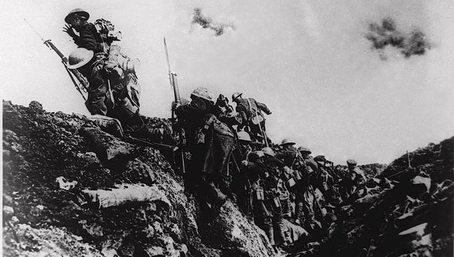 U.S. troops climb out of a trench during World War I.