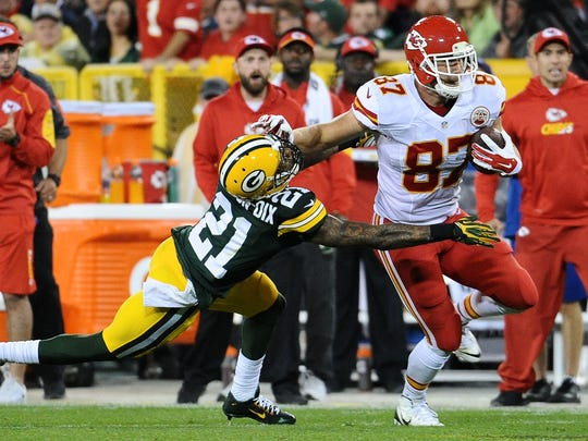 Kansas City Chiefs tight end Travis Kelce (87) stiff arms Green Bay Packers free safety Ha Ha Clinton-Dix (21) in the second quarter. The Green Bay Packers hosted the Kansas City Chiefs at Lambeau Field in Green Bay, Wis. on Monday, Sept. 28, 2015.