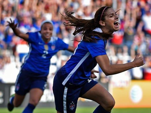 USA's Alex Morgan, 13, celebrates after scoring the