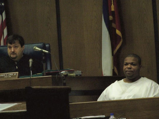 Odell Hallmon (right) testifies at Curtis Flowers' sixth murder trial. Hallmon said Flowers admitted to the Tardy Furniture Store slayings.