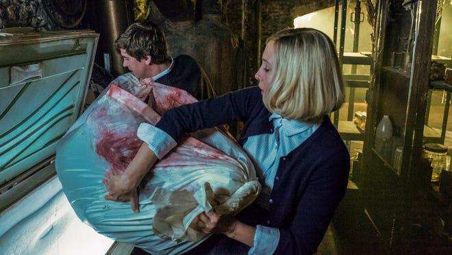 Maternal bonding: Norman Bates (Freddie Highmore) and Mother (Vera Farmiga) move a body on A&E's 'Bates Motel.'