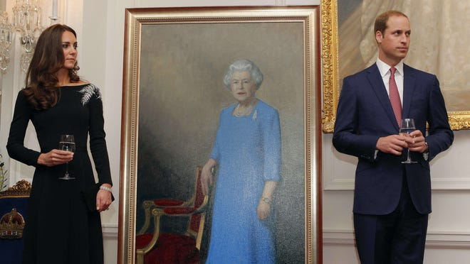Prince William and Duchess Kate next to a portrait of Queen Elizabeth II in New Zealand in April.
