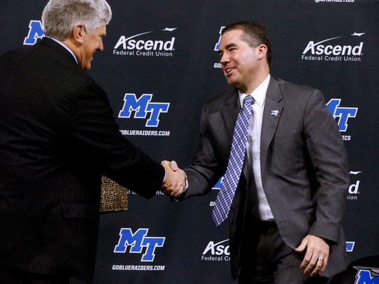 MTSU Athletic Director Chris Massaro presents the new