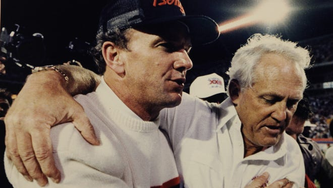 """Bengals head coach Sam Wyche, left, and San Francisco head coach Bill Walsh said, """"I love you,"""" to each other after the 49ers beat Cincinnati in the final seconds of Super Bowl XXIII in Miami, January 22, 1989."""