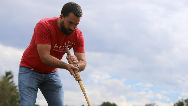 Jeremy Rasnic plays croquet at the former site of the Highland Green golf course in Jackson, Tenn., on Wednesday, Oct. 12, 2016.