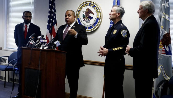 Community Oriented Policing Services Office Director Ronald Davis speaks during a news conference in December 2015 to announce the launch of the COPS collaborative reform process with the Milwaukee Police Department.