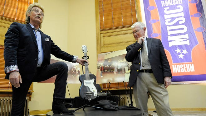 Carl Perkins' son Stan, left, and Dr. John Jennings address the crowd after unveiling a display with Carl's first electric guitar at the Legends of Tennessee Music Museum in the Carnegie Center for Arts and History in Jackson, Tenn., on Monday, Feb. 27, 2017. Dr. Jennings is the owner of the guitar.