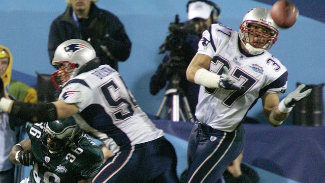 New England Patriots safety Rodney Harrison (37) intercepts a pass intended for Philadelphia Eagles' Brian Westbrook (36) as Patriots linebacker Tedy Bruschi (54) helps on the play in the first quarter during Super Bowl XXXIX at Alltel Stadium on Sunday, Feb. 6, 2005, in Jacksonville, Fla. The Patriots won, 24-21.