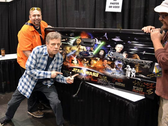 """Trey Laymon, far left, is pictured with """"Star Wars"""" actor Mark Hamill in April 2015 at the Star Wars Celebration convention in Anaheim, Calif. Hamill is just one among numerous """"Star Wars"""" stars who have signed Laymon's Ford Raptor pickup truck. (Just the truck's tailgate is shown here.)"""