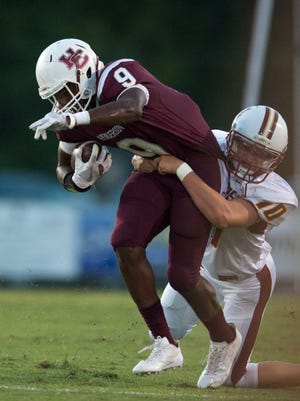 Henderson CountyÕs Dada Simpson (9) gets tackled by Gibson Southern's Landon Mayer (10) during Henderson County High School's game against Gibson Southern High School at Henderson County High School in Henderson, Ky., on Friday, Sept. 8, 2017. Gibson Southern won 28-20.