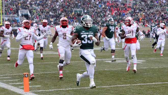 MSU running back Jeremy Langford heads  into the endzone for his second touchdown against Rutgers in East Lansing Saturday 11/22/2014.