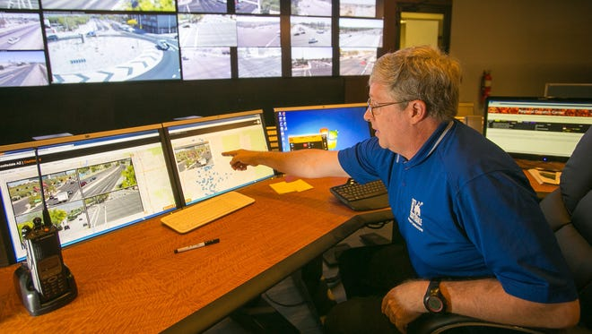 Engineer Steve Ramsey monitors traffic at the new Traffic Management Center in Scottsdale on Monday, March 24, 2014.
