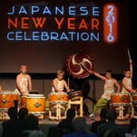 The Matsuriza Taiko Drummers perform for the crowd Saturday during the Japanese New Year Celebration at the Rex Theatre.