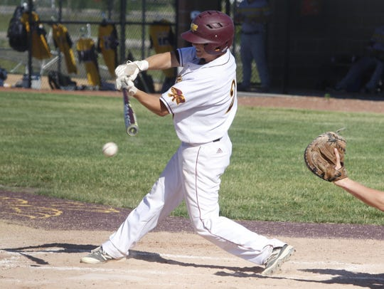 Ankeny's Seth Harpenau hits a grounder during the first