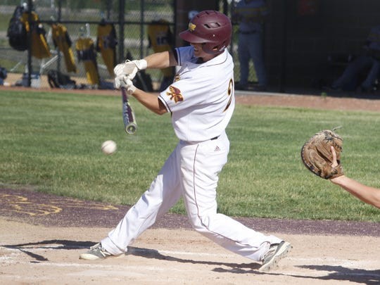 Ankeny's Seth Harpenau hits a grounder during the first game of a doubleheader against visiting Southeast Polk on June 5. The Hawks swept the twinbill by scores of 4-2 and 8-5.