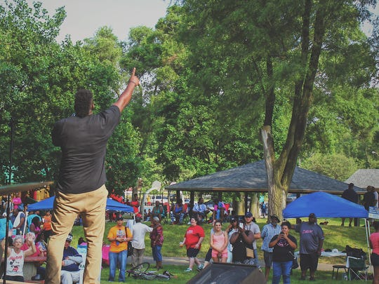 Odell Miller performs with his group 'God's Army' during Battle Creek's Juneteenth and Family Day Celebration at Claude Evans Park on June 17.