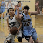 Redwood's Samantha Navarro goes for lay-up against Monache's Kayla Watson on Thursday in Visalia. Navarro scored 13 points to help lead the Rangers to a win.
