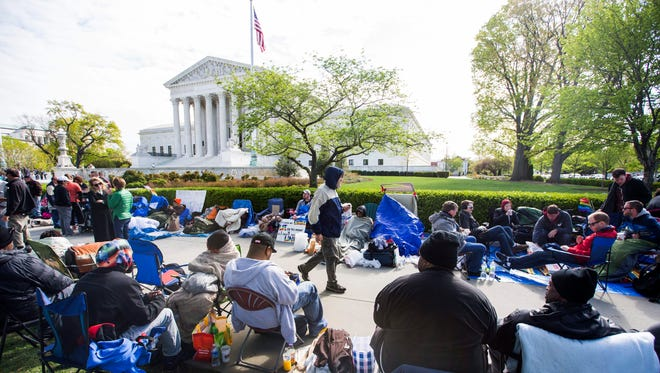 People line up outside the Supreme Court on April 27, 2015, a full day before the high court was scheduled to hear oral arguments over gay marriage.