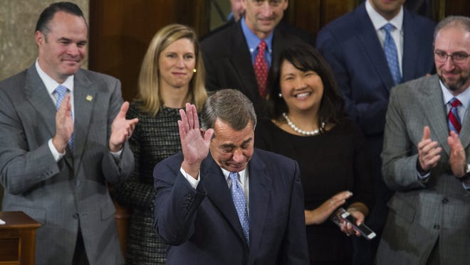 Outgoing House Speaker John Boehner acknowledges applause after his farewell speech on the floor in October.