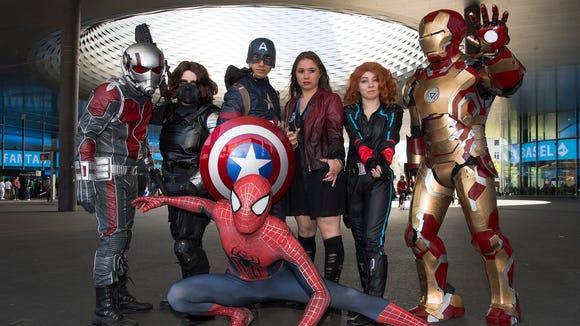 Fans in Marvel cosplay at a Swiss Comic-Con.