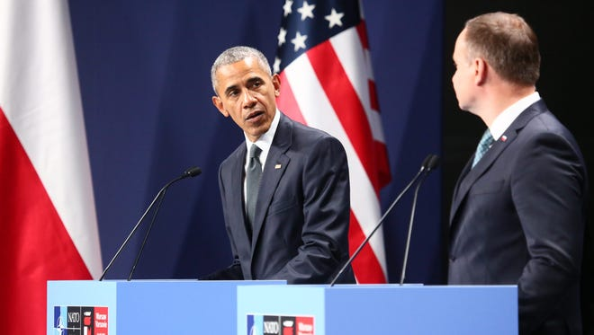 President Obama and Polish President Andrzej Duda at a press conference after a meeting just before the NATO Summit at the National Stadium in Warsaw, Friday.