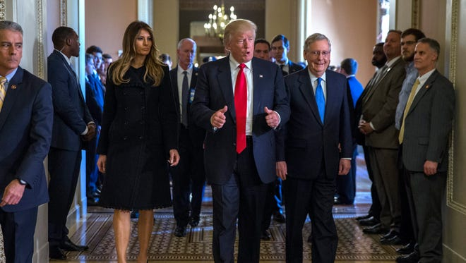 Donald Trump with Melania Trump and Senate Majority Leader Mitch McConnell on Capitol Hill on Nov. 10, 2016.