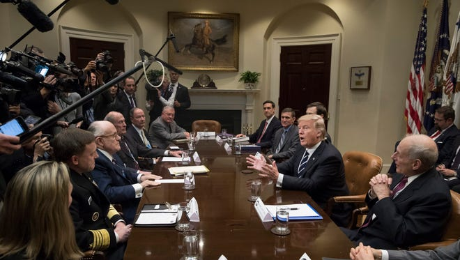 President Donald Trump (2-R) attends a meeting on cyber security in the Roosevelt Room of the White House, in Washington, DC, USA, 31 January 2017.