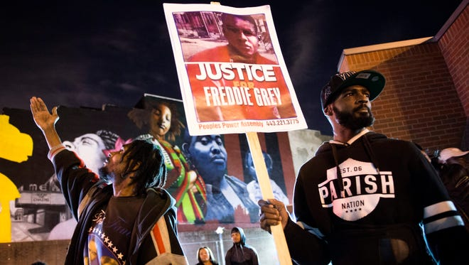Protesters rally in Baltimore.