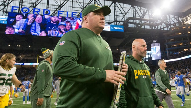 Green Bay Packers head coach Mike McCarthy leaves the field after the game Sunday at Ford Field.