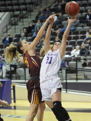 ACU's Kayla Galindo, right, drives against Midwestern