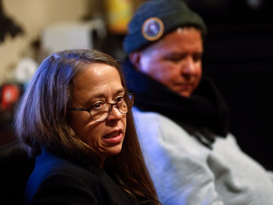 At left, outgoing Capacity Builders Inc. Executive Director Rachel Nawrocki and artist Michael Billy talk on Feb. 20 at the Capacity Builders offices in Farmington.