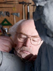 Robert Hess works on the sculpture of Willamette University coach Charles Bowles in 2006. The statue was placed near the finish line of the track inside McCulloch Stadium and dedicated in 2012.
