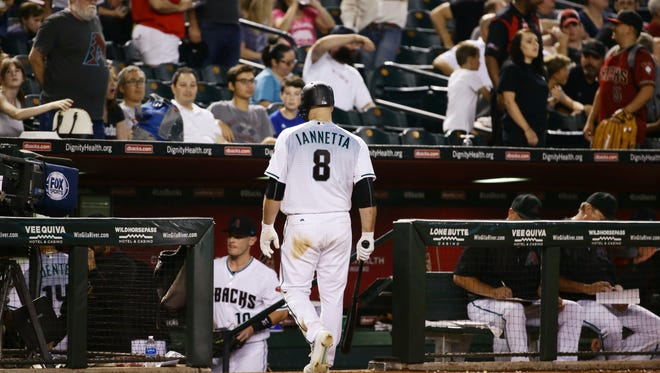 Arizona Diamondbacks Chris Iannetta walks-off the field after striking-out looking against the Philadelphia Phillies in the 9th inning on Friday, Jun. 23, 2017 at Chase Field in Phoenix, Ariz.