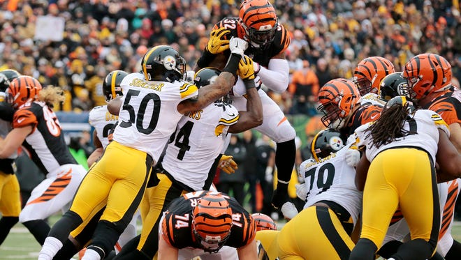 Cincinnati Bengals running back Jeremy Hill (32) is stopped short at the goal line attempting to go over the top for a touchdown in the first quarter of the NFL Week 15 game between the Cincinnati Bengals and the Pittsburgh Steelers at Paul Brown Stadium in downtown Cincinnati on Sunday, Dec. 18, 2016. At halftime the Bengals led 20-9.