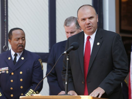 Then-Public Safety Director Troy Riggs (right) and