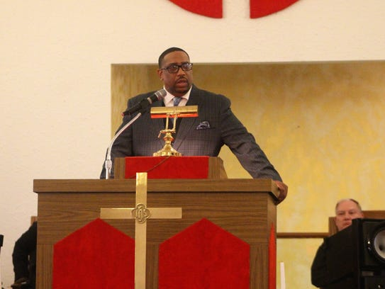 Pastor Corredon Rogers speaks to members of his church on Saturday during a fellowship dedicated to Eli Brown.