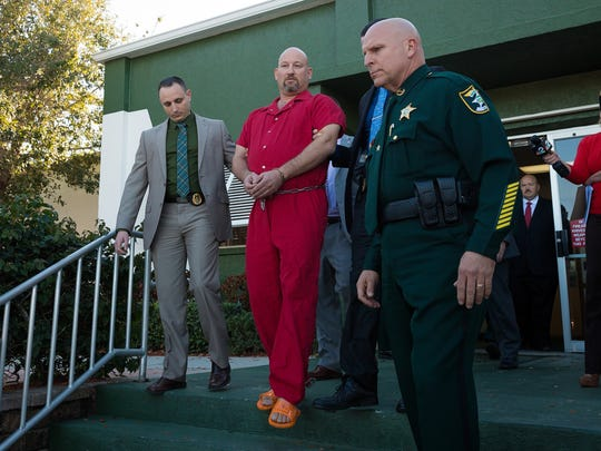 Mark Sievers, center, is led from the Lee County Sheriff's Office headquarters after being arrested on Friday, Feb. 26, 2016, in Fort Myers. Sievers was arrested on a second-degree murder charge in connection with the June 2015 death of his wife Dr. Teresa Siever. (David Albers/Staff)