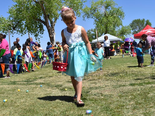Jenaya Hicks, 6 years old, searches for Easter eggs during Easter in the Park on Saturday afternoon.