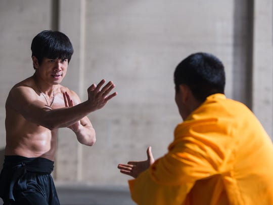 "Philip Ng stars as Bruce Lee and Yu Xia stars as Wong Jack Man in ""Birth of the Dragon."""