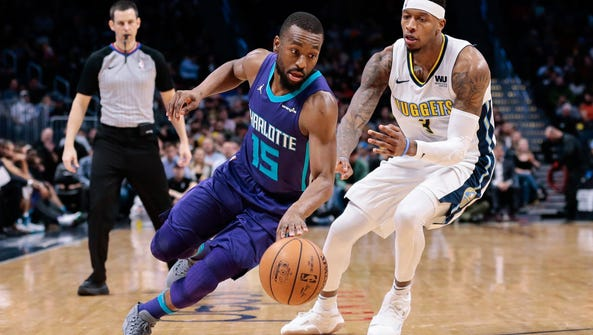 Charlotte Hornets guard Kemba Walker (15) controls