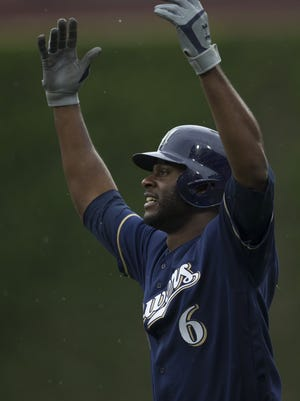 Lorenzo Cain of the Brewers gestures after hitting an RBI infield single in the top of the fifth inning against the Phillies on Sunday.
