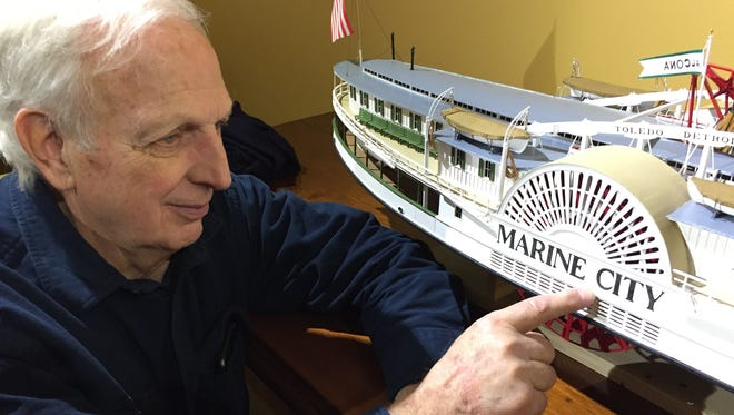 "Gary Kohs looks at a wooden model of the steamer ""Marine City."" Members of a social group plan to honor Kohs, who died Dec. 15, with a memorial bike ride."