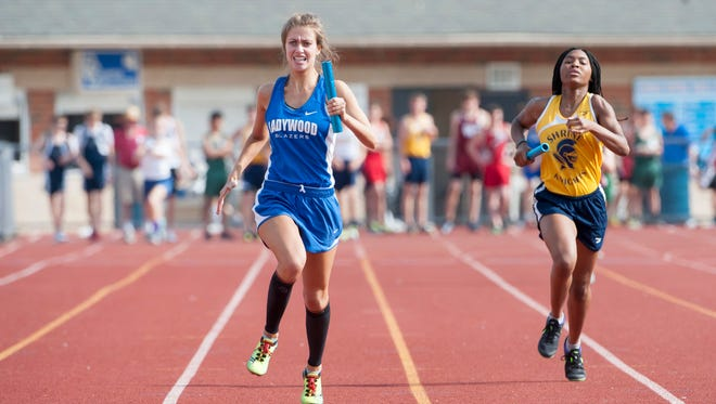 Dana Santilli, left, anchor's the Ladywood team for a first place finish in the 4x200 relay.