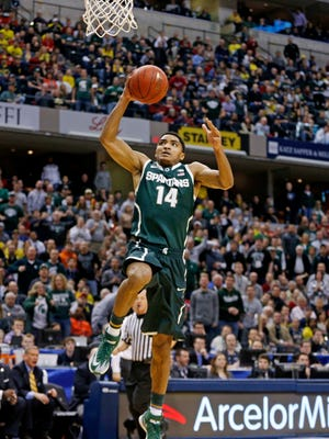 Gary Harris and Michigan State topped Michigan for the Big Ten title.