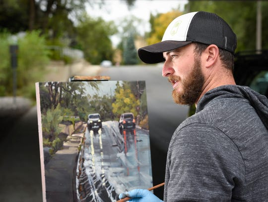 Artist Dan Mondloch talks about his plein air style as he works on a scene along the Mississippi River in this 2017 photo.